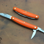 62 Pocket Carver Orange Delrin